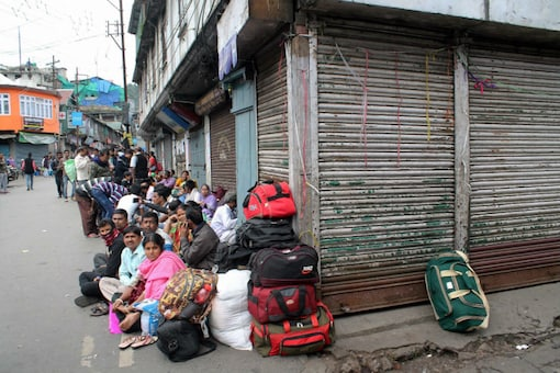 """Tourists stranded following violent clashes between police and GJM supporters in Darjeeling on June 9. GJM president Bimal Gurung has asked tourists to leave the hills because of the possibility of """"untoward"""" incidents. (PTI)"""