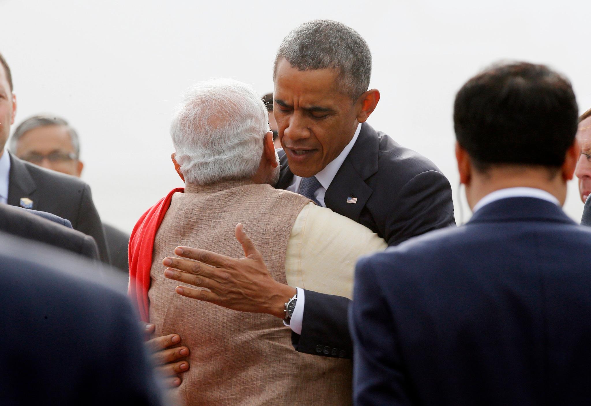 U.S. President Barack Obama hugs India's Prime Minister Narendra Modi as he arrives at Air Force Station Palam in New Delhi