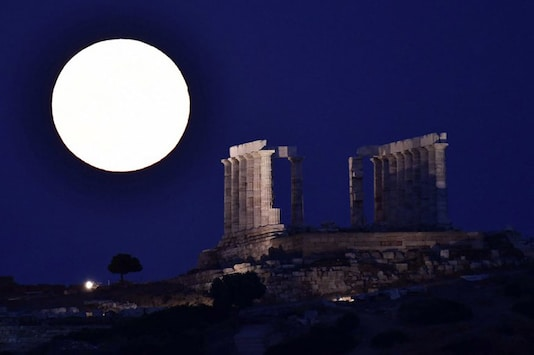 The full moon rises by the ancient temple of Poseidon (Neptun) at cape Sounio, some 65 km southeast of Athens, on July 9, 2017. (Representative Image: AFP)