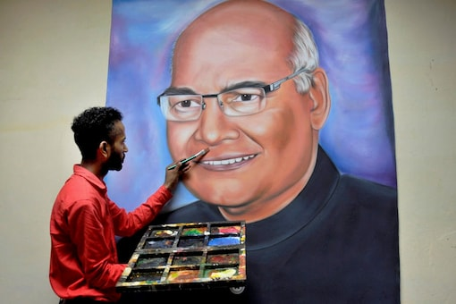Artist Jagjot Singh Rubal finishing his painting of the newly elected President of India, Ram Nath Kovind, at his home studio in Amritsar on Thursday. (Image: PTI)