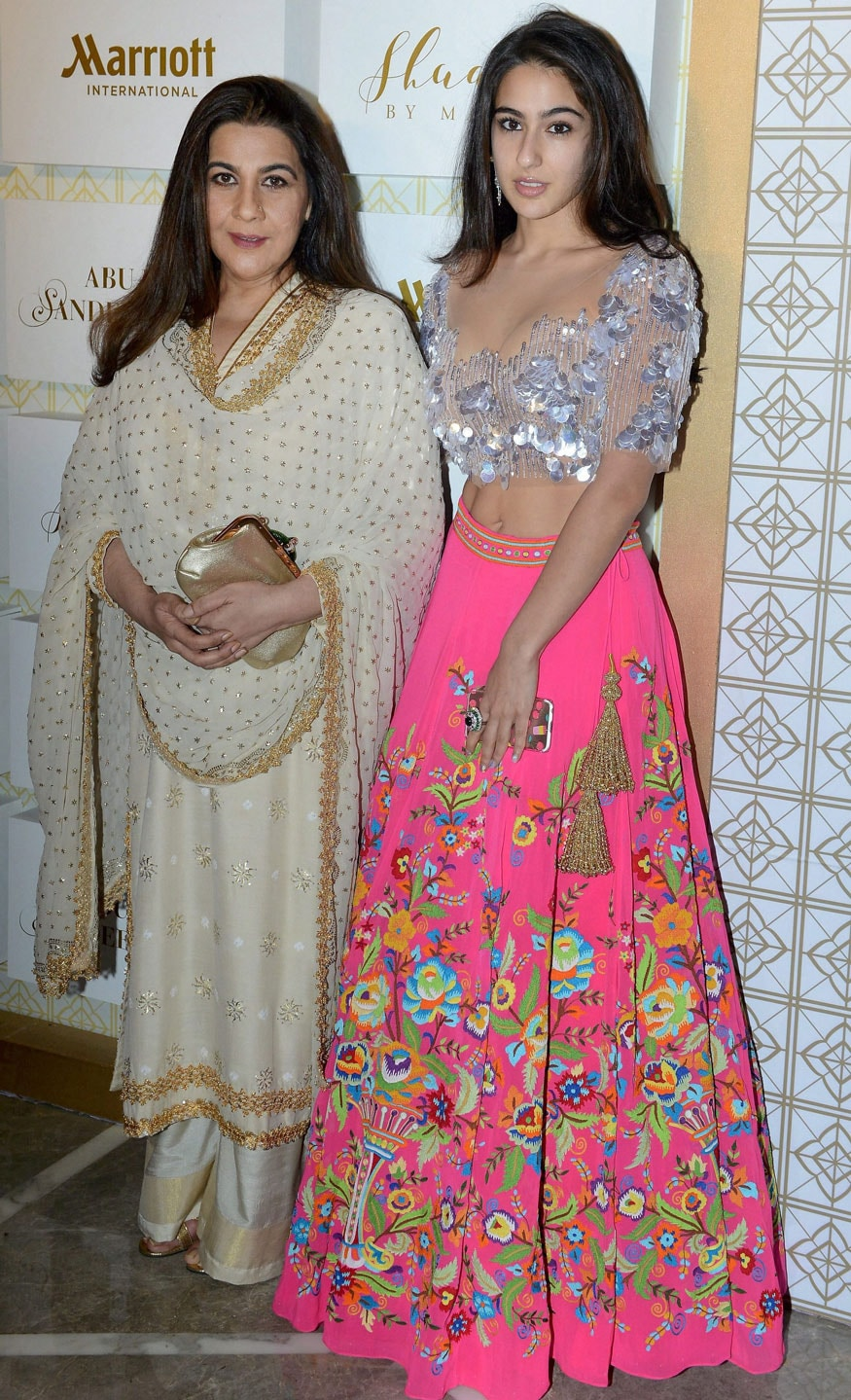 Actress Amrita Singh and her daughter Sara Ali Khan at a fashion show in New Delhi on Friday. (Image: PTI)