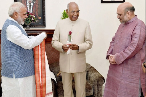 Prime Minister Narendra Modi and BJP President Amit Shah greet Ram Nath Kovind on being elected as the 14th President of India on Thursday. (PTI Photo)