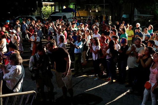 Opposition supporters wait for results of the unofficial plebiscite against President Nicolas Maduro's government and his plan to rewrite the constitution, in Caracas, Venezuela July 16, 2017 (REUTERS)