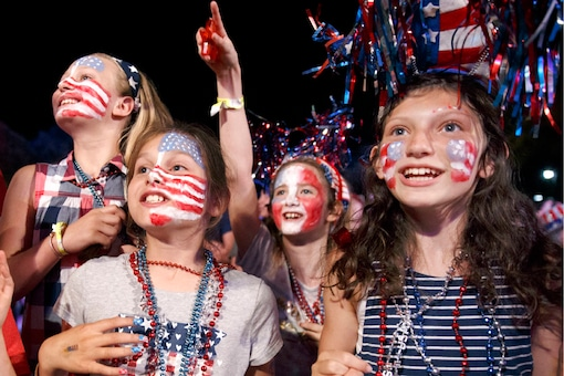 Children sing along during a rehearsal for the annual Boston Pops Fireworks Spectacular in Boston. (AP Photo/ Michael Dwyer)
