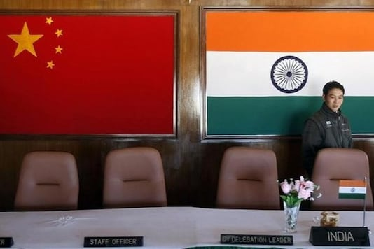 In this file photo, a man walks inside a conference room used for meetings between military commanders of China and India, at the Indian side of the Indo-China border at Bumla in Arunachal Pradesh. (Photo: Reuters/Adnan Abidi)