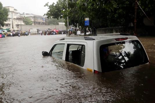 A car seen seen submerged in a flooded street following heavy rains in Mumbai on Tuesday, August 29, 2017. (AP Photo/Rajanish Kakade)