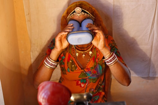 A woman goes through the process of eye scanning for Aadhaar. (REUTERS)