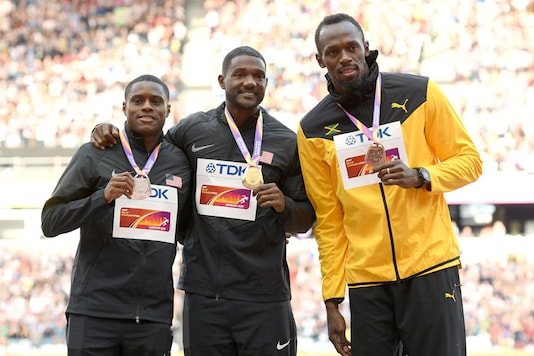 Christian Coleman, Justin Gatlin and Usain Bolt with their respective 100m medals at the IAAF World Championships in London (Getty Images)