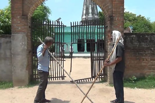 People from the upper caste are guarding the temple with sticks and rods. (Photo: CNN-News18)