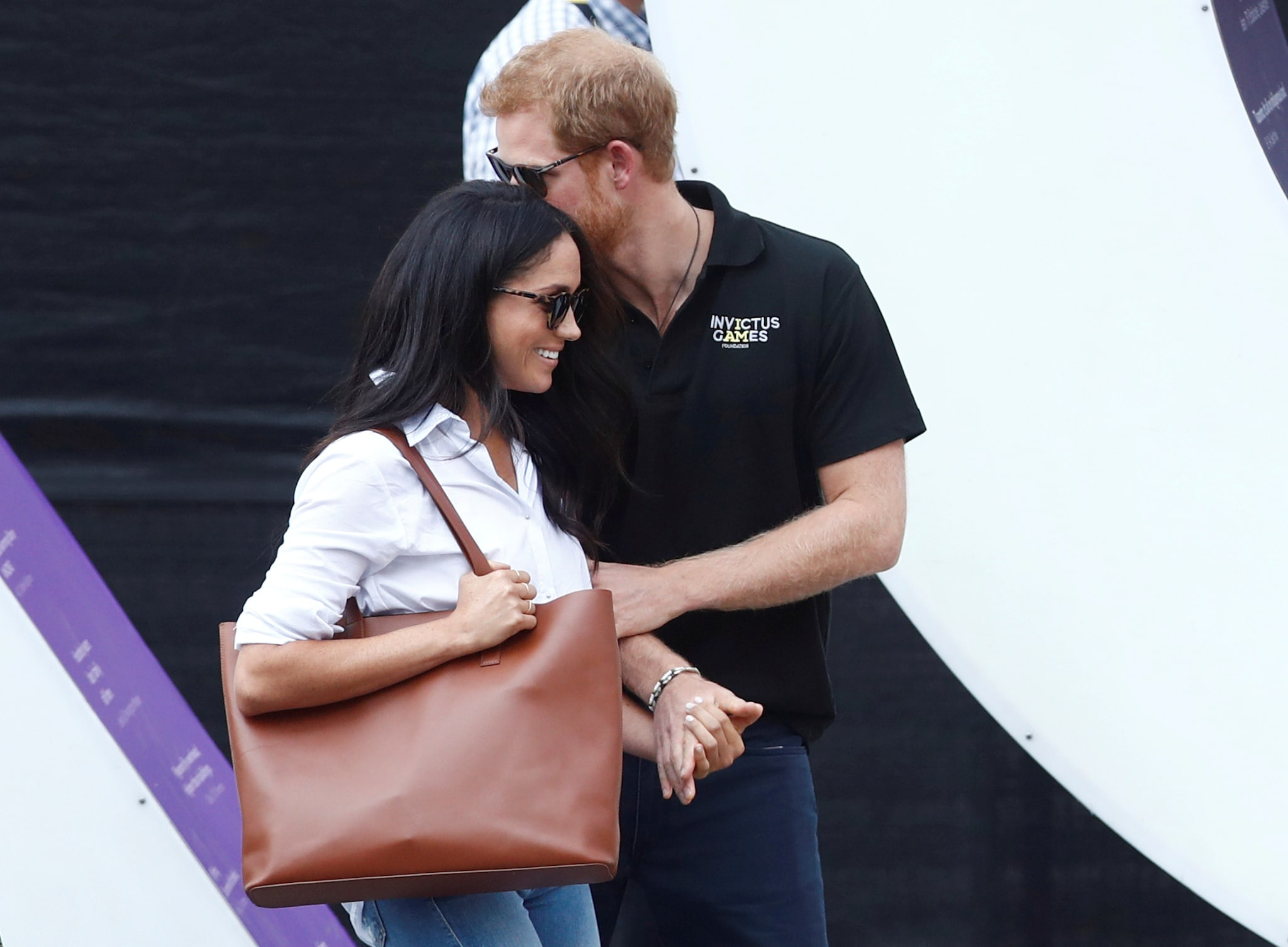 Prince Harry arrives with girlfriend actress Meghan Markle at the wheelchair tennis event during the Invictus Games in Toronto, Canada, September 25, 2017. REUTERS/Mark Blinch