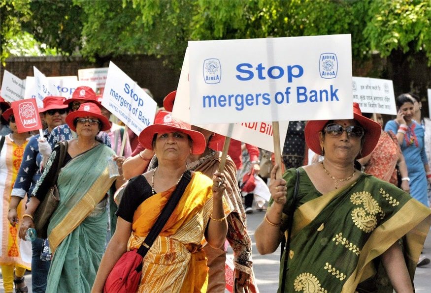 New Delhi: Members of United Forum of Bank Unions and Bank Employees hold placards during a protest rally against government for their various demands, in New Delhi on Friday. (Image: PTI)