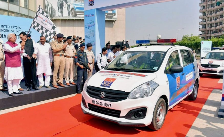 Gurugram: Chief Minister of Haryana Manohar Lal and A K Tomer, Executive Director, Maruti Suzuki India Limited, flagging off 35 vehicles handed over to Haryana Police by Maruti Suzuki India Limited under its CSR initiative in Gurugram on Friday. (Image: PTI)