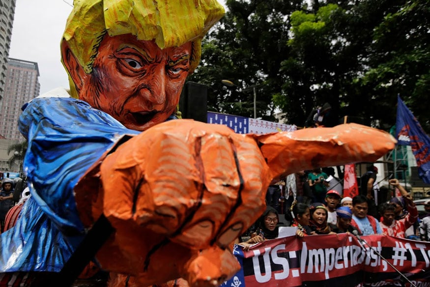 Manila: Protesters sing beside an effigy of U.S. President Donald Trump as they tried to march towards the U.S. Embassy in Manila, Philippines on Friday, Sept. 15, 2017. The group is protesting against the alleged increasing intervention of the U.S. military in the ongoing war in Marawi and growing presence in Mindanao. (Image: AP)