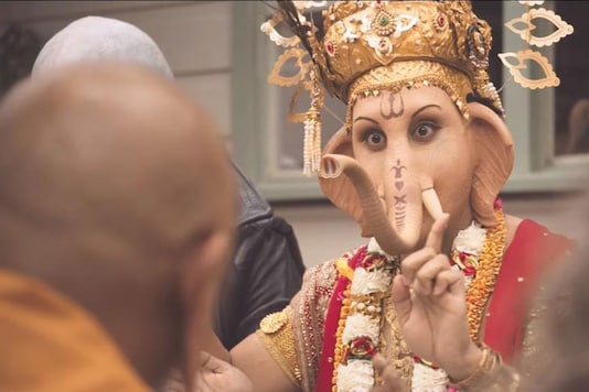 In the TV commercial, a number of religious figures, including Lord Ganesha, are seen sitting down together to a lamb-based meal and raising a glass to the meat.