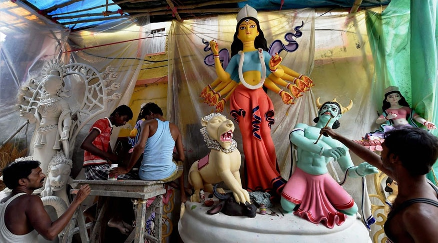Kolkata: Artists busy in preparing idol of Goddess Durga at Kumartuli in Kolkata on Friday for upcoming Durga Puja festival. (Image: PTI)
