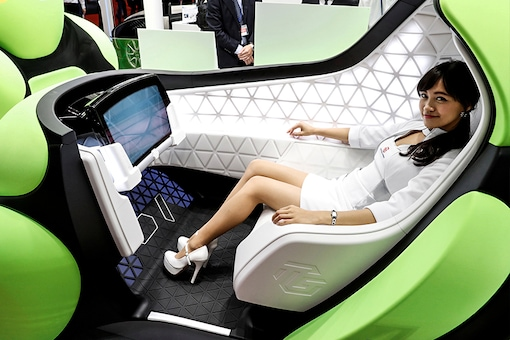 A-model-presents-the-Flesby,-a-one-seater-mobility-concept-car-exhibited-by-Japan's-auto-parts-maker-Toyoda-Gosei,-during-a-media-preview-of-the-45th-Tokyo-Motor-Show-in-Tokyo. (Photo: Reuters)