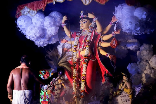 Representative Image from PTI (An idol of Hindu goddess Durga is taken in a procession for immersion in Kolkata, India, Tuesday, Oct. 3, 2017. )