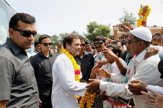 Congress Vice-President Rahul Gandhi being welcomed by his supporters during a roadshow in Padara village in Vadodara. (Image: PTI)