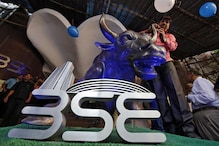 Sensex Rises over 100 Points, Nifty Reclaims 12,000