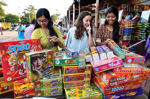 Women buy firecrackers for the festival of Diwali. (Image: AP)