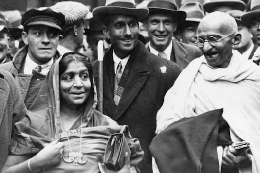 Indian nationalist leader and organizer of the Indian National Congress's campaign of passive non-cooperation, Mahatma Gandhi (Mohandas Karamchand Gandhi, 1869 - 1948) with his wife, shortly before his arrest for conspiracy. (Photo: Getty Images)