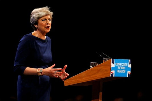 Britain's Prime Minister Theresa May addresses the Conservative Party conference in Manchester on October 4, 2017. (Reuters)