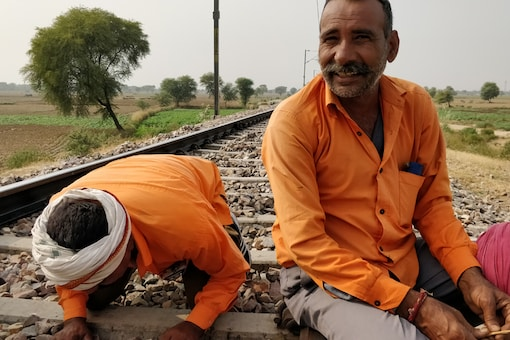 The body was between the railway tracks but the head was outside it. He had injury marks on his legs and limb, say railway workers.