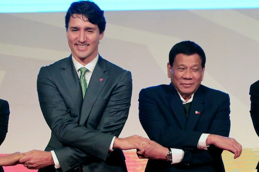 Philippines' President Rodrigo Duterte holds hands with Canada Prime Minister Justin Trudeau for a family photo during the ASEAN-Canada 40th anniversary commerative summit in metro Manila, Philippines. Image: Reuters