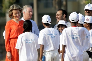 Belgium's Queen Mathilde and King Philippe with Virender Sehwag during a cricket clinic at Oval Maidan in Mumbai. (Image: AP)