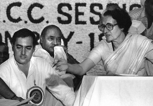 In this picture taken early 1984 shows Indian prime minister Indira Gandhi (R) and her son Rajiv (L) at a Congress Party meeting in New Delhi. (Image: AFP)