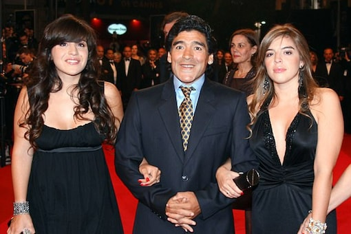 File image of Diego Maradona with his two daughters. (AFP Image)