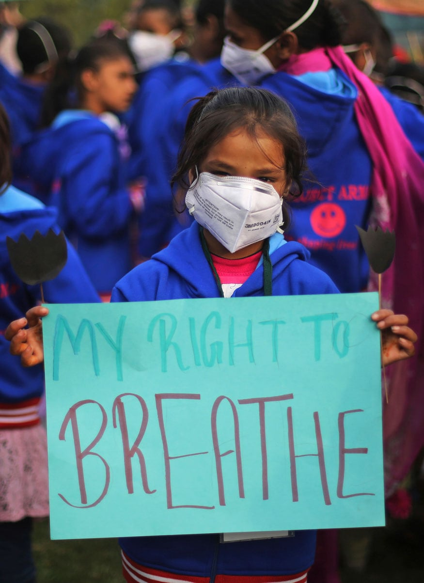 Schoolgirl wears a mask to fight pollution and participate in a demonstration to demand clean air in New Delhi on November 14, 2017. (Image: PTI)