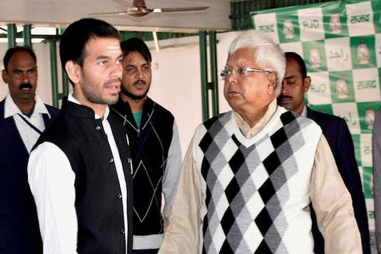 File photo of Tej Pratap Yadav along with his father Lalu Prasad. (Photo: PTI)