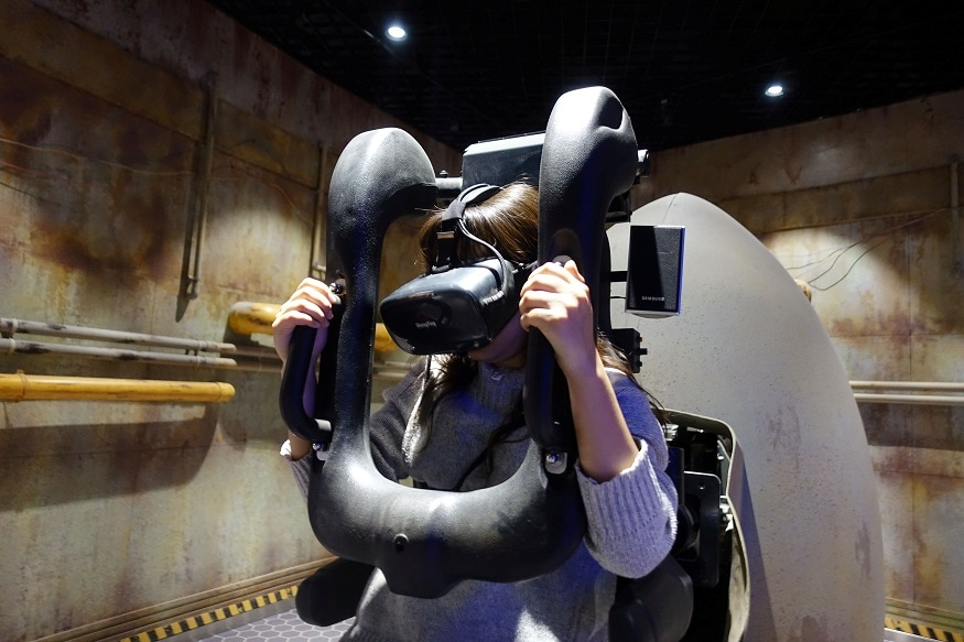 "Staff member demonstrates a test-run of the VR attraction ""Explore the Stars"", at the Oriental Science Fiction Valley theme park in Guiyang"