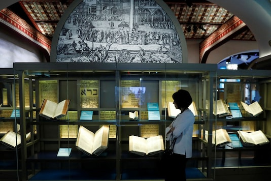 A visitor looks at various Bibles during a preview at the Museum of the Bible in Washington, US. Image: Reuters