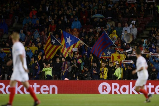 Barcelona supporters wave pro-independence Catalan Estelada flags during the Spanish league football match FC Barcelona vs Sevilla FC at the Camp Nou stadium in Barcelona. (AFP)