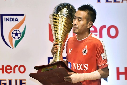 Malsawmtluanga Shylo player of Aizawl FC defending champion carrying the I-League trophy at a press conference for the launch of I-League football championship 2017 in New Delhi. (Image: PTI)