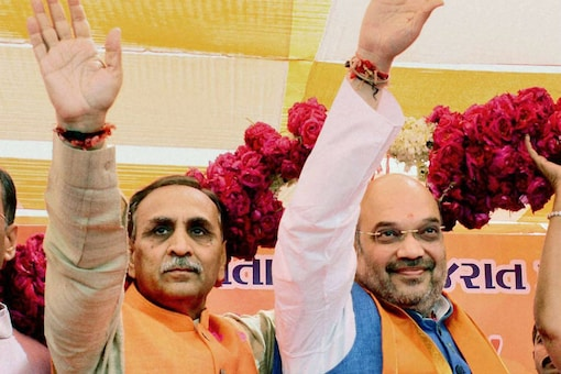 File photo of Vijay Rupani with BJP chief Amit Shah. (PTI)