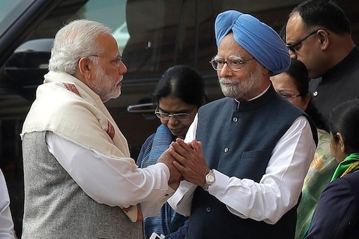 Prime Minister Narendra Modi shakes hand with his former counterpart Manmohan Singh during a ceremony to pay tributes to security officials who lost their lives in the 2001 attack on Indian parliament, in New Delhi. (Image: AP)