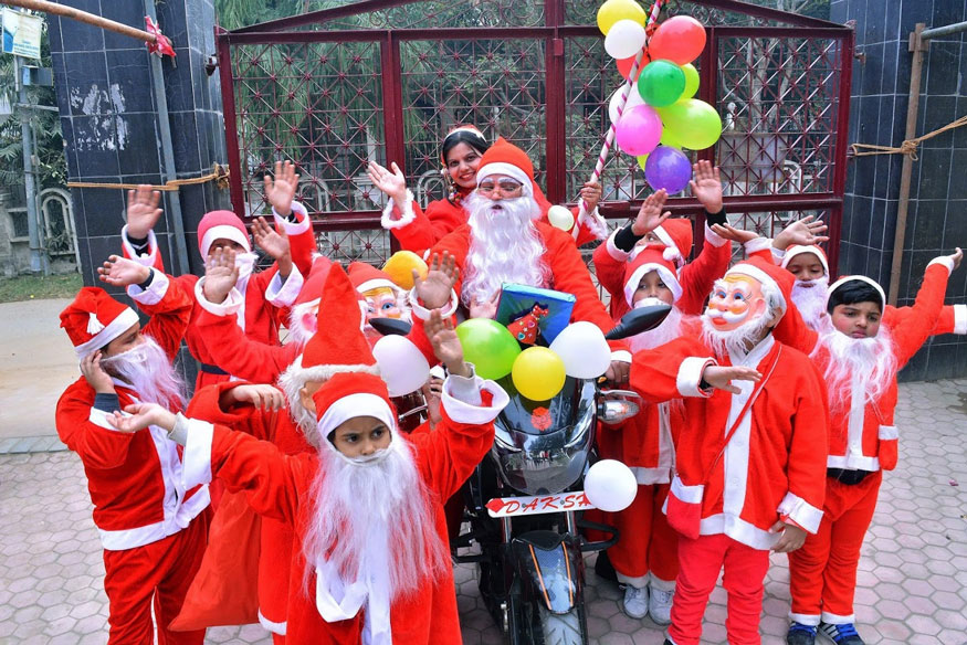 Children, dressed up as Santa Claus, celebrating Christmas at their school in Mathura. (Image: PTI)