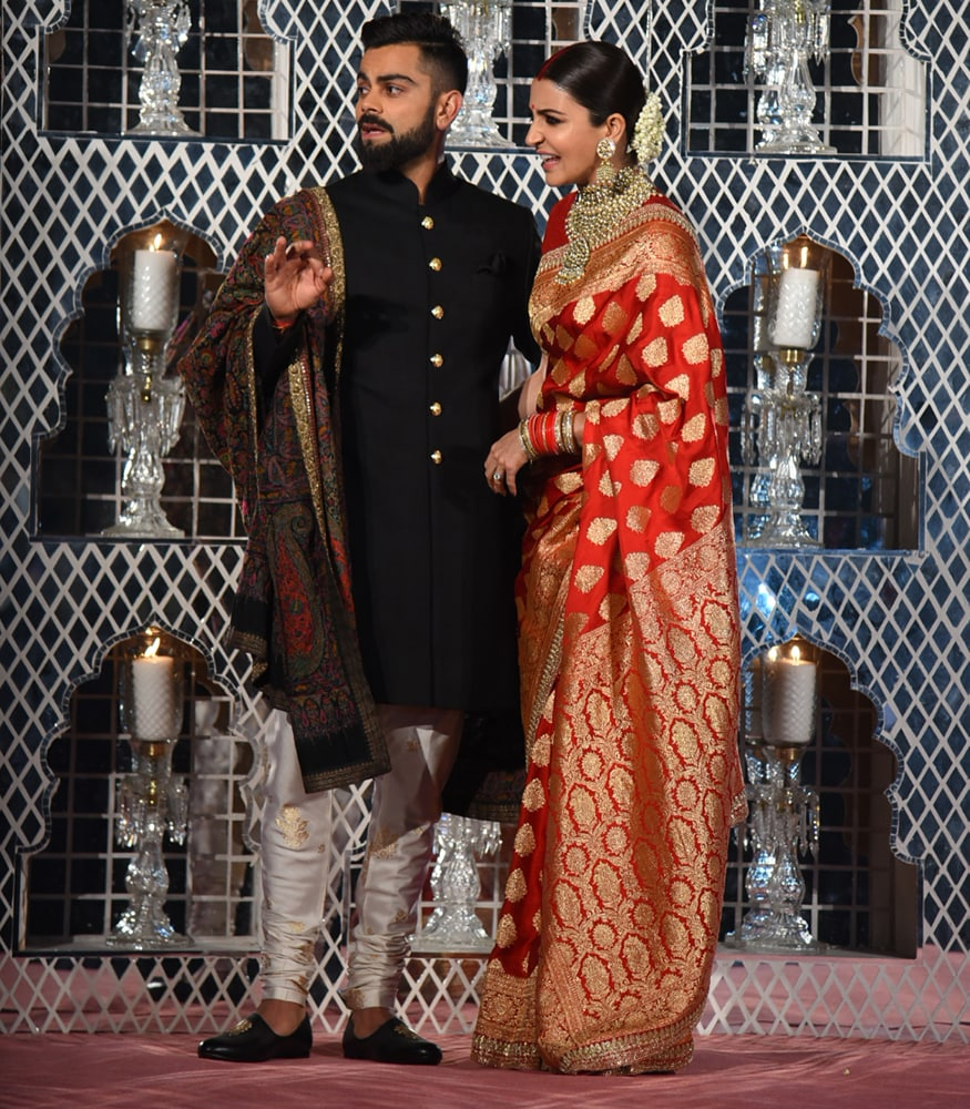 Virat Kohli and Anushka Sharma pose together during their wedding reception at the Taj Diplomatic Enclave in New Delhi on December 21, 2017. (Image: Yogen Shah)
