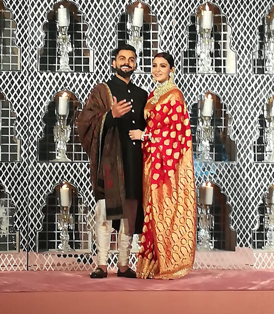 Virat Kohli and Anushka Sharma during their wedding reception at the Taj Diplomatic Enclave in New Delhi on December 21, 2017. (Image: Yogen Shah)
