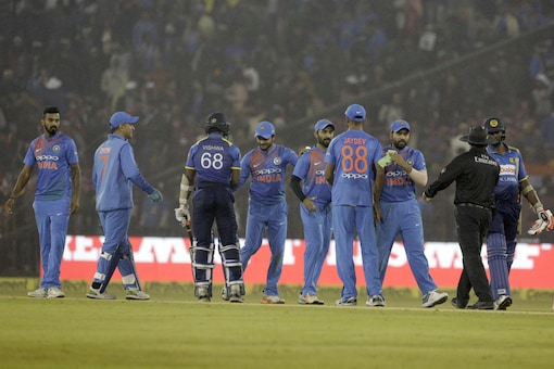 Indian players greet Sri Lankan batsmen after India won the 2nd T20I in Indore. (AP Image)