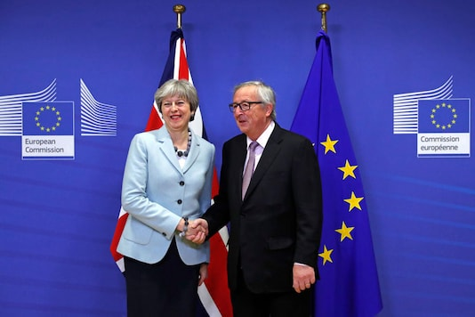 Britain's Prime Minister Theresa May is welcomed by European Commission President Jean-Claude Juncker at the EC headquarters in Brussels, Belgium (REUTERS)