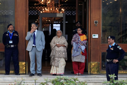 Kulbhushan Jadhav's mother Avanti (C) and wife, Chetankul, wait for their car after meeting him at Ministry of Foreign Affairs in Islamabad, Pakistan on December 25. (Photo: REUTERS/)