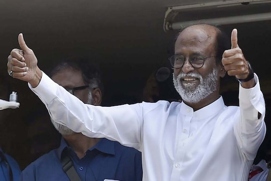 Rajinikanth gestures at supporters after announcing his entry into the politics, on the final day of a six-day-long photo session with fans, in Chennai on Sunday. (PTI Photo)