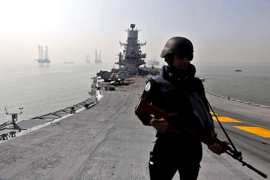 An Indian Navy personnel stands guard during a media preview on the flight deck of INS Vikramaditya, Indian Navy's aircraft carrier. (Reuters)