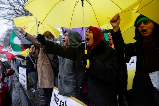 Opponents of Iranian President Hassan Rouhani hold a protest outside the Iranian embassy in west London. (Reuters)