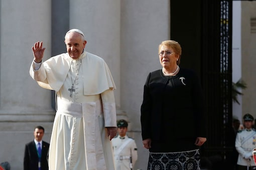 Pope Francis waves to the people next to Chile's president Michelle Bachelet outside the La Moneda Presidential Palace during his visit in Santiago, Chile. (Reuters)