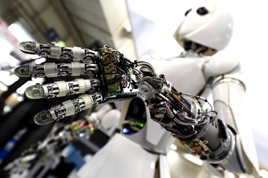 A robot is displayed at the Robotics Innovation Center booth during preparations at the CeBit computer fair in Hanover